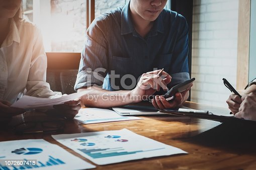 1032388356 istock photo Businessman using calculator  are meeting to plan sales to meet targets set in next year. audit budget and financial concept 1072607418