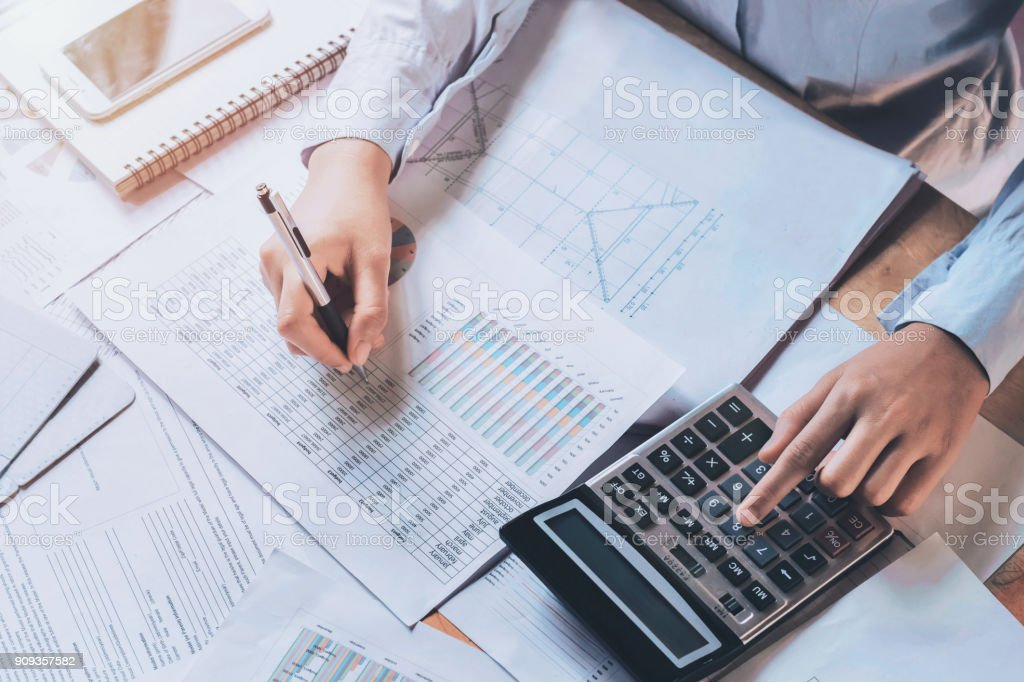 businessman using calculator for calculate budget. concept finance and accounting stock photo