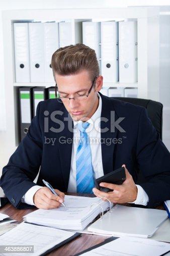 istock Businessman Using Calculator 463886807