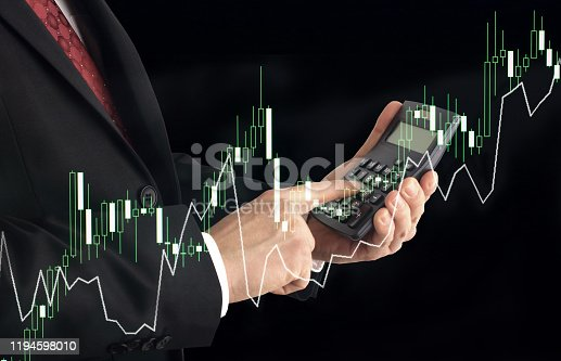 611747524istockphoto Businessman using calculator with finance and banking profit graph of stock market trade indicator financial 1194598010