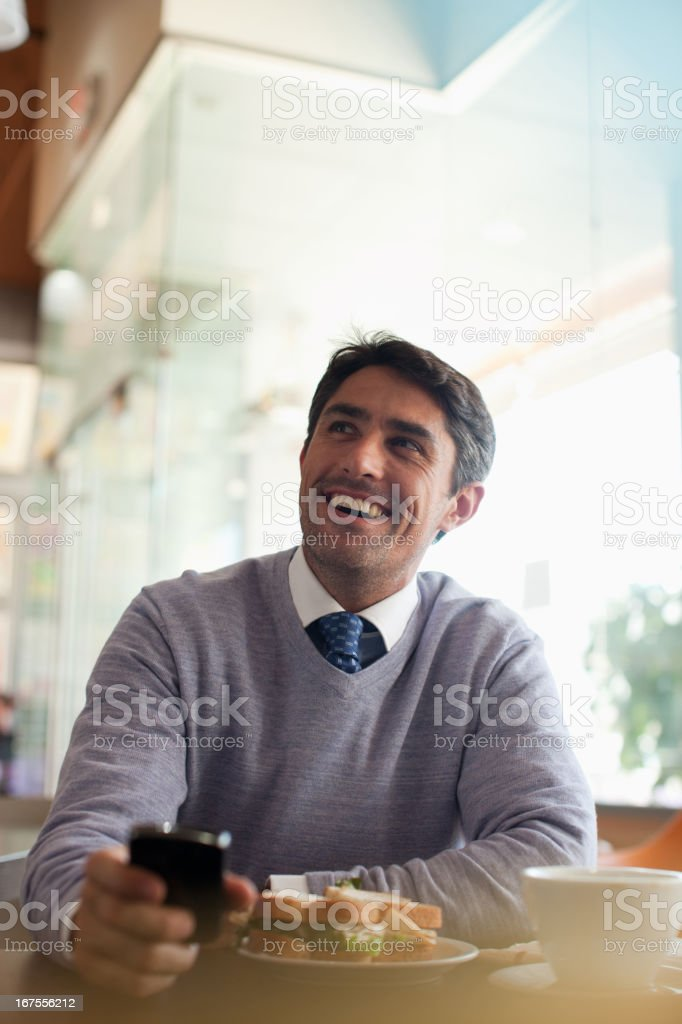 Businessman using cell phone in cafe royalty-free stock photo