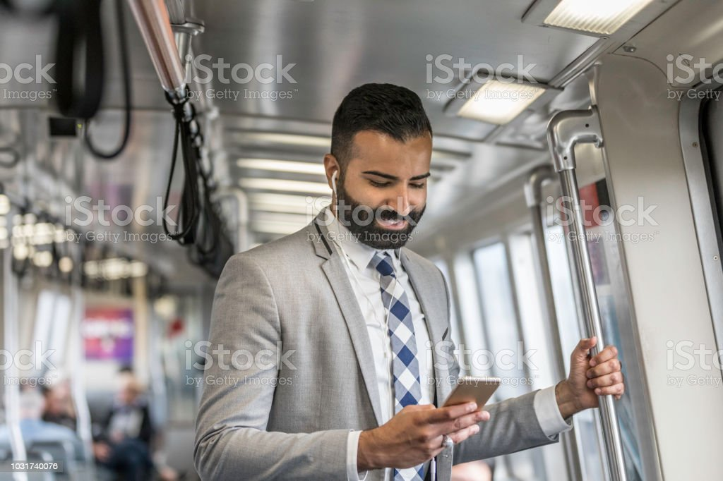 Businessman Using Cell Phone on a Train stock photo