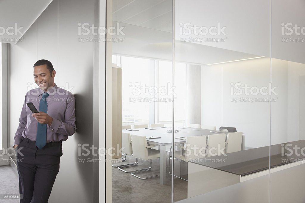 Businessman using cell phone royalty-free stock photo
