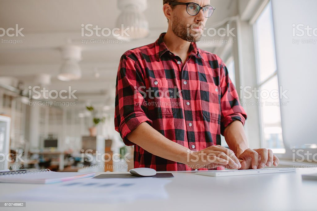 Businessman using computer in modern office. stock photo