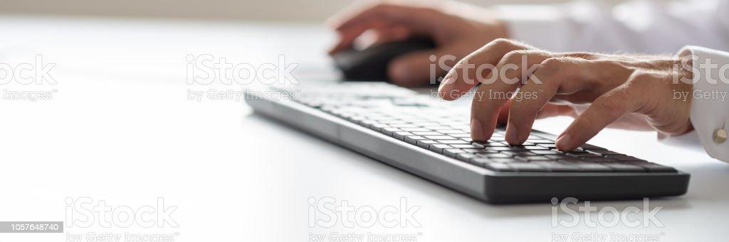 Businessman using computer keyboard stock photo