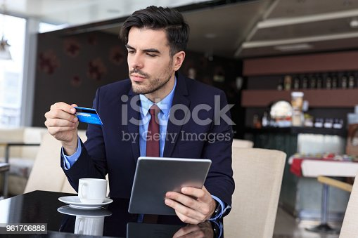 502723248 istock photo Businessman using credit card and tablet 961706888