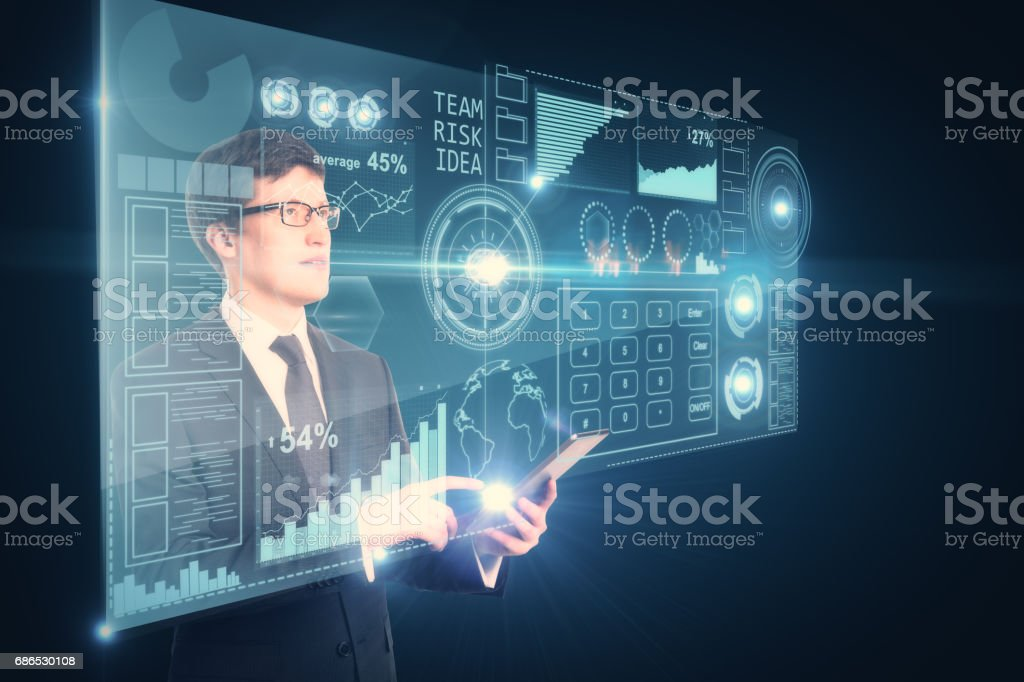 Businessman using device with charts royalty free stockfoto
