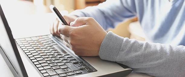 Businessman using digital laptop, smart phone concept stock photo