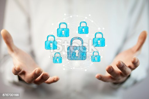 istock Businessman using digital padlock to secure 876700166