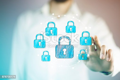 istock Businessman using digital padlock to secure 876700174