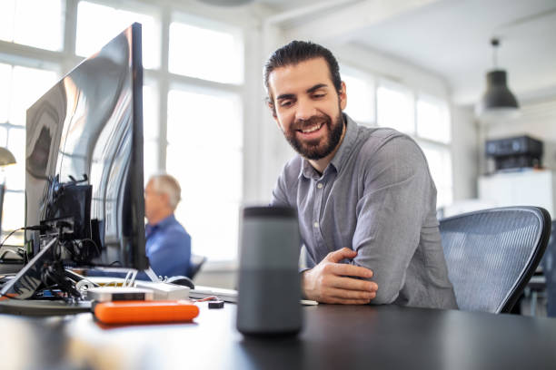 Businessman using digital speaker at office stock photo