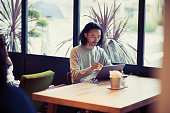 Businessman using digital tablet at cafe