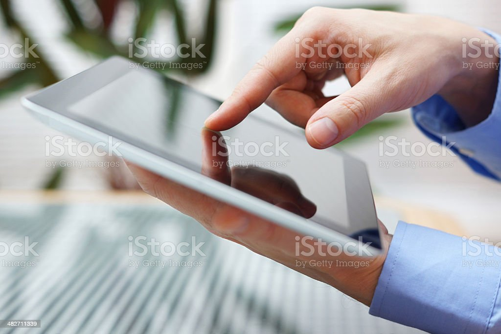 businessman using digital tablet, closeup stock photo