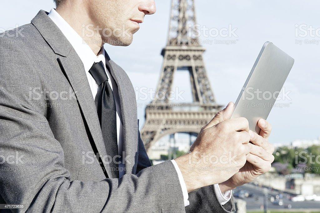 Businessman Using Digital Tablet Computer at Eiffel Tower Paris royalty-free stock photo