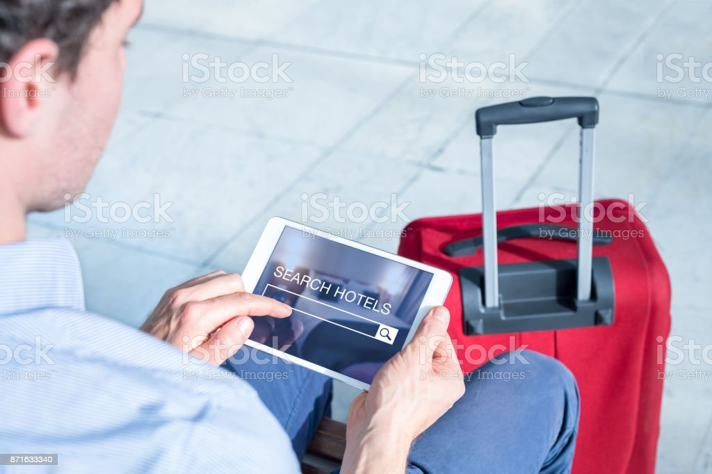 Businessman using digital tablet computer to search book hotel online stock photo
