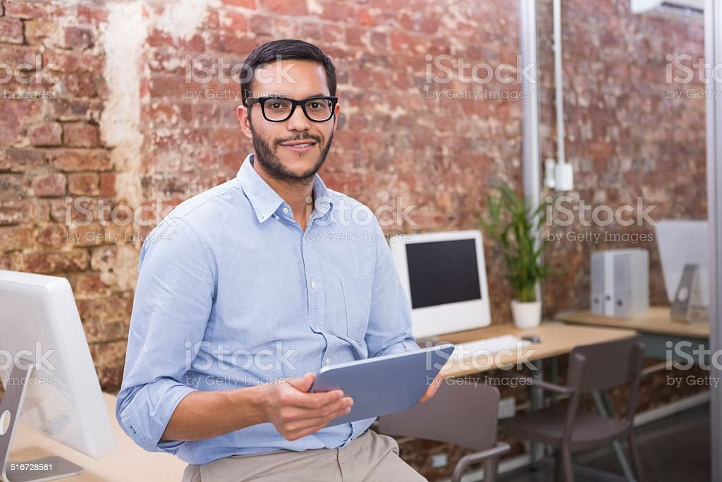 Businessman using digital tablet in office stock photo