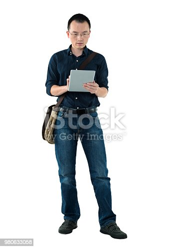 istock Businessman using digital tablet on white background 980633058