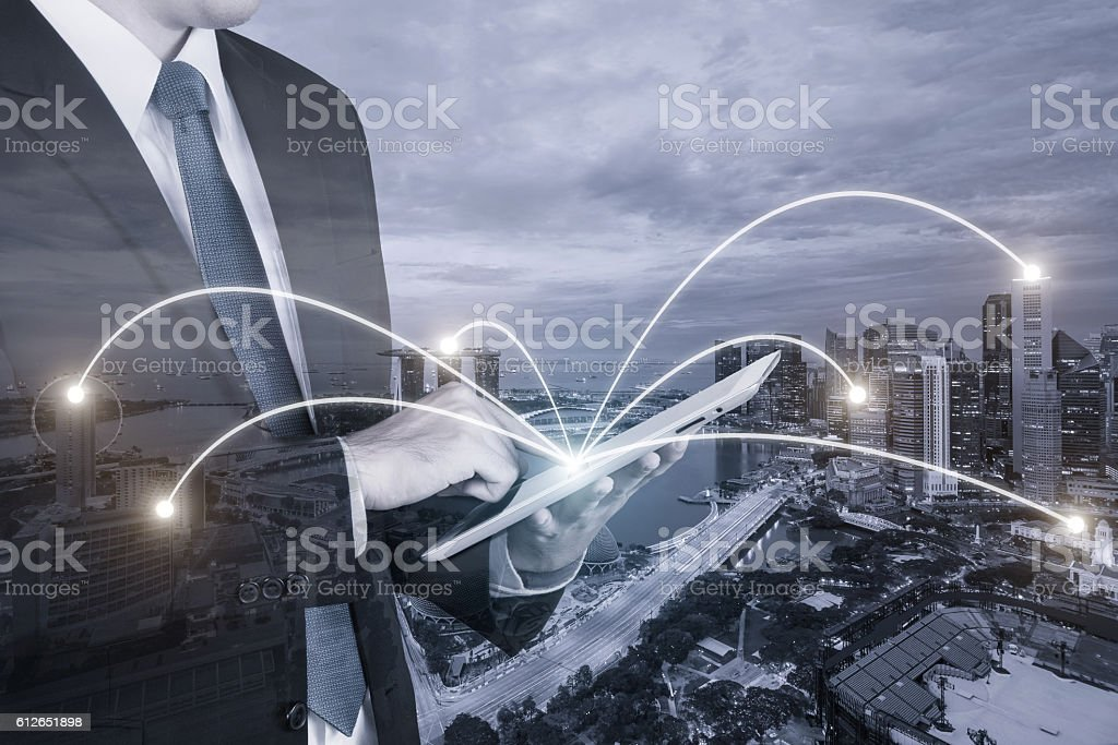 Businessman using digital tablet pc with network connection of Singapore stock photo