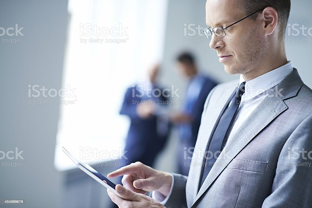 Businessman using digital tablet royalty-free stock photo