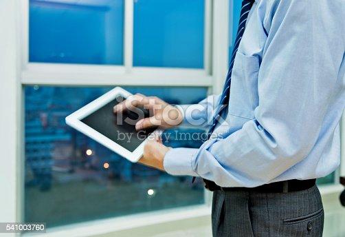 istock Businessman using digital tablet 541003760