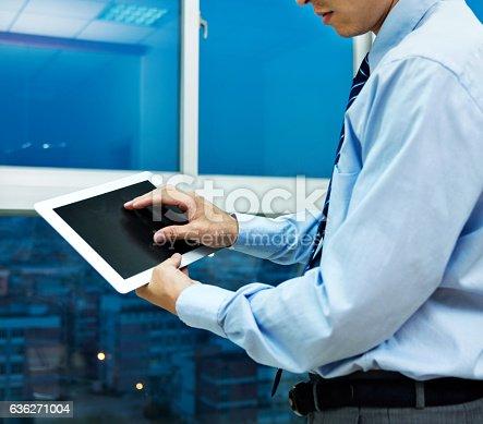 istock Businessman using digital tablet 636271004