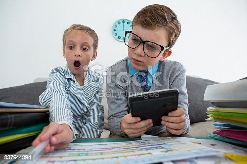 istock Businessman using digital tablet while surprised colleague analyzing files 837944394