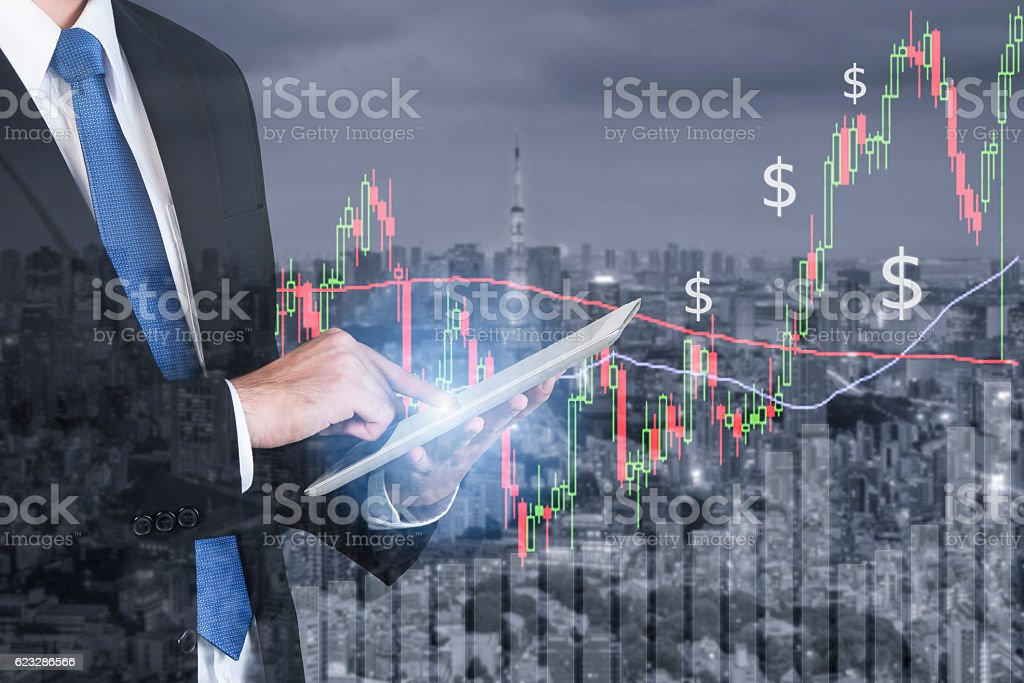 Businessman using digital tablet working with stock market chart stock photo