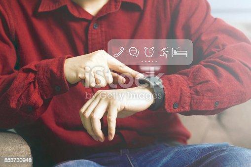 831622420 istock photo Businessman using futuristic smartwatch 853730948