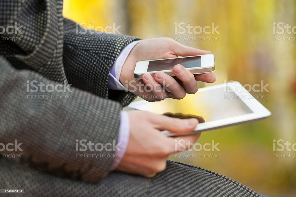 Businessman Using Gadgets royalty-free stock photo