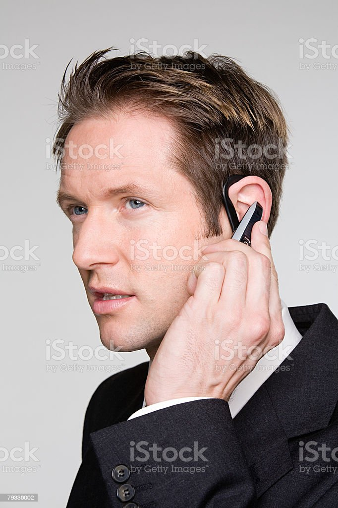 Businessman using hands free device royalty-free stock photo