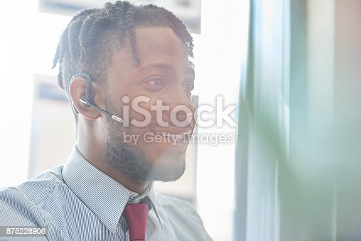 istock Businessman using headset in the office 875228906