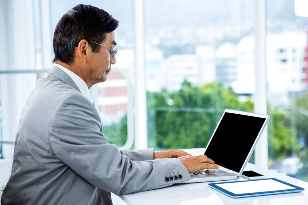 Businessman using his computer stock photo