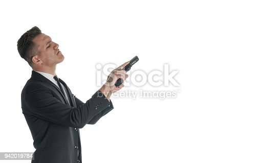 471947536 istock photo Businessman Using His gun 942019784