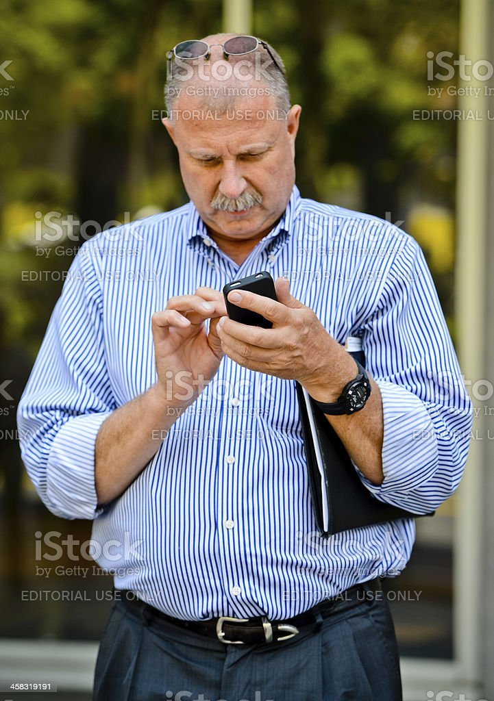 Businessman using his mobile phone on Los Angeles street stock photo