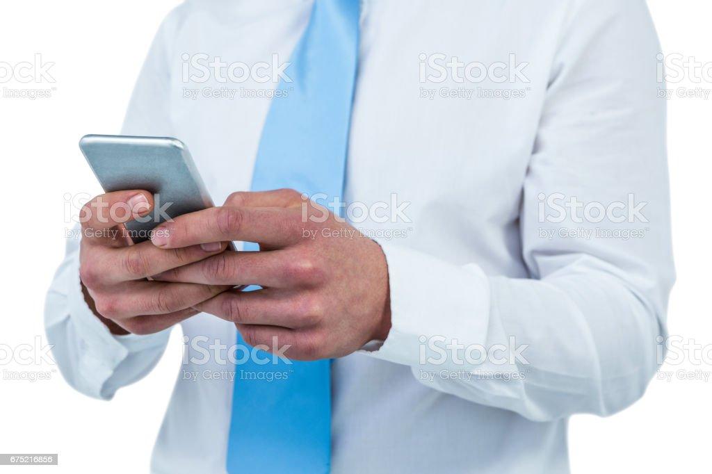Businessman using his phone royalty-free stock photo
