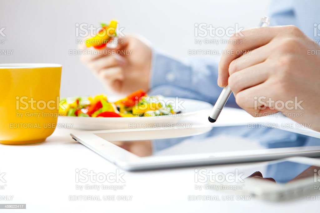 Businessman using iPad and iPhone royalty-free stock photo