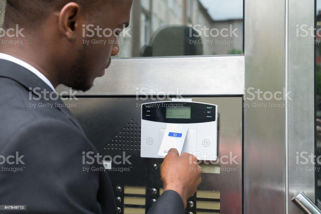 Businessman Using Keycard To Open Door stock photo