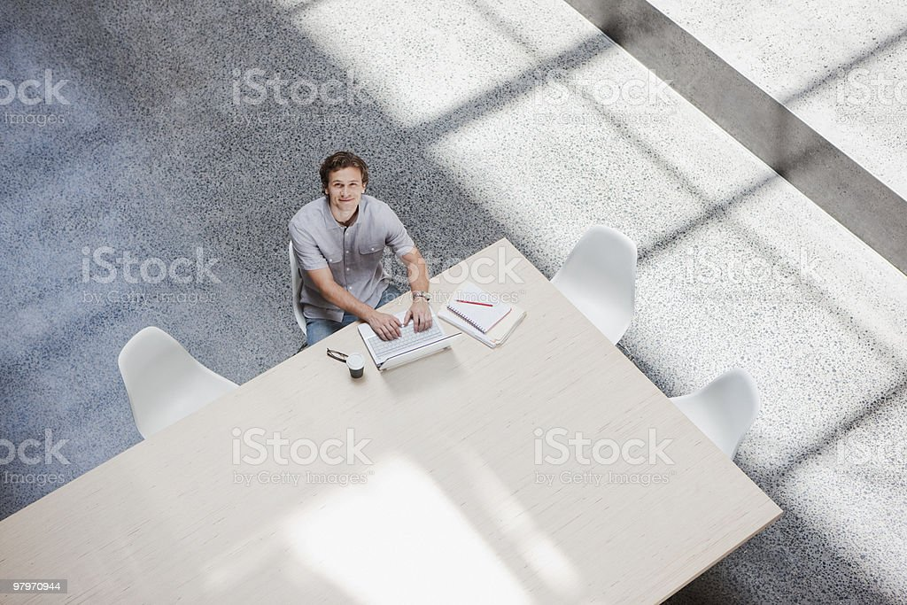 Businessman using laptop at conference table royalty-free stock photo