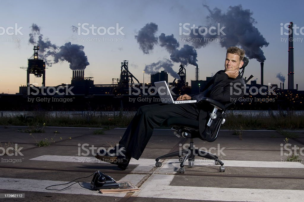businessman using laptop at sunset royalty-free stock photo