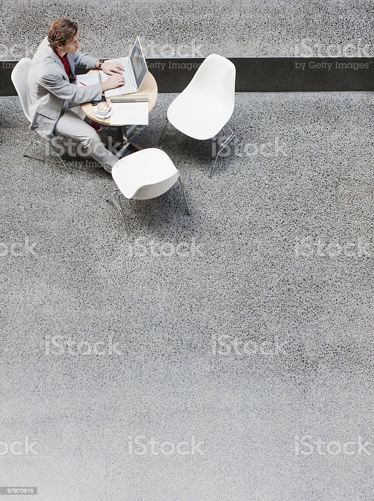 Businessman using laptop at table royalty-free stock photo