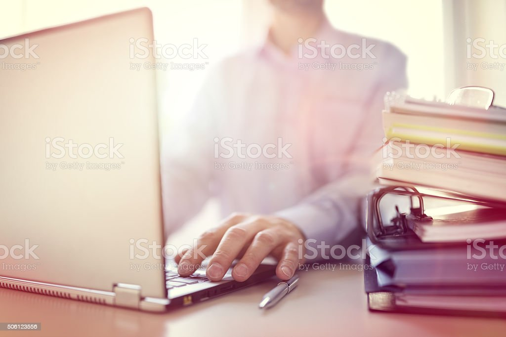 Businessman using laptop computer stock photo