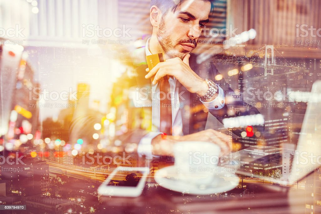 Businessman using laptop for online shopping stock photo