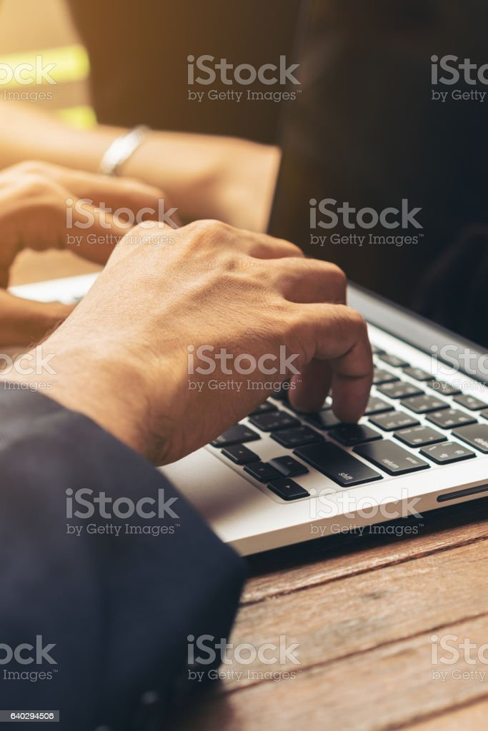 Businessman using laptop in Business meeting stock photo