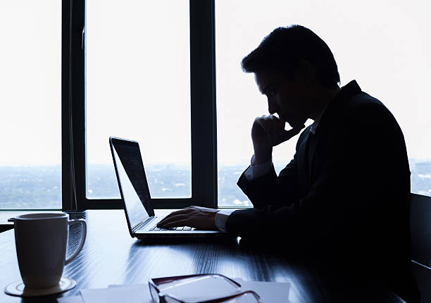 Businessman using laptop in the office stock photo