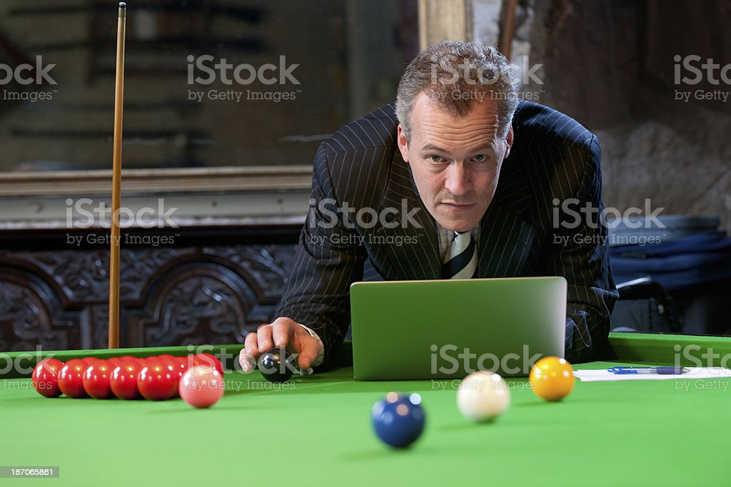 businessman using laptop on snooker table royalty-free stock photo