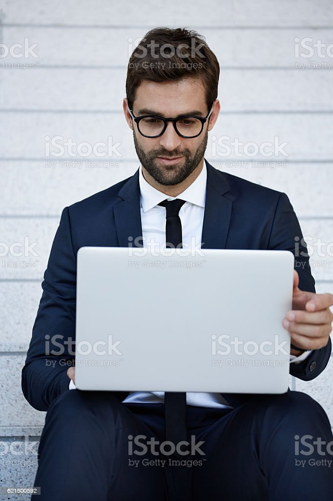 Businessman using laptop on staircase foto stock royalty-free