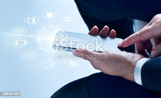 istock Businessman using mobile payments, holding circle global and icon customer 538481030