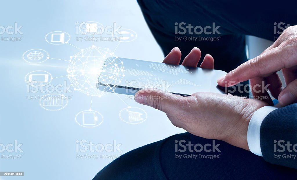 Businessman using mobile payments, holding circle global and icon customer stock photo