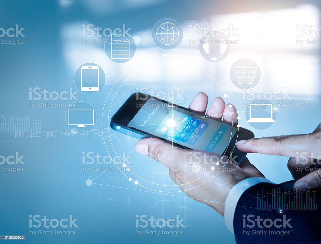 Businessman using mobile payments online shopping and icon customer stock photo