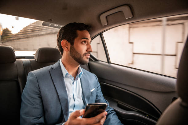 Businessman using mobile ph stock photo